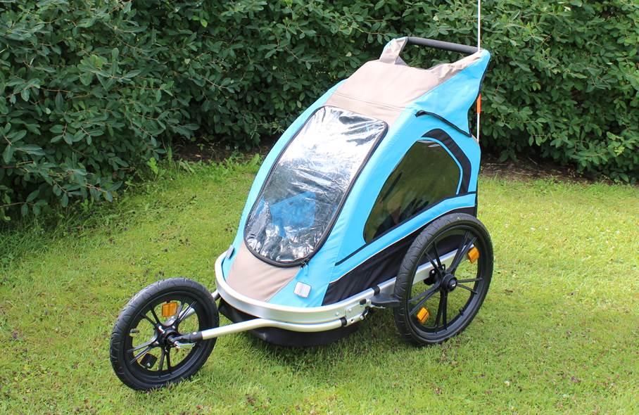 Sininen Spectra -merkkinen pyörän peräkärry.